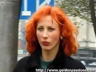 mature redhead obtaining a piss in a public park