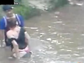 naughty milf copulates a boy inside the river