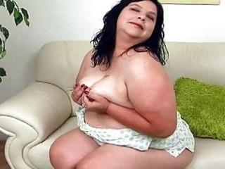 large black haired lady with giant bosom sticks