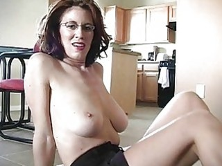 sporty busty ginger momma works on her cock