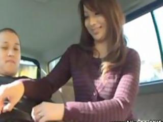 japanese lady gives handjob on backseat of car