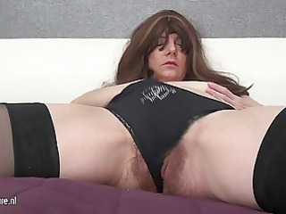 furry older  mother and her huge toy