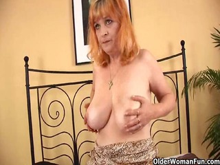 redheaded granny with giant breast licks strapon