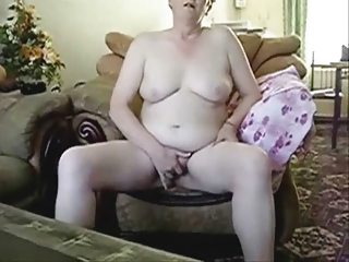 horny grandma dildoing into front of hubby