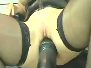 horny leather woman marian drives giant vibrator