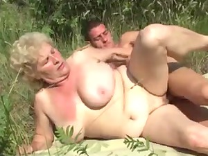 german granny outside with freshman man by troc